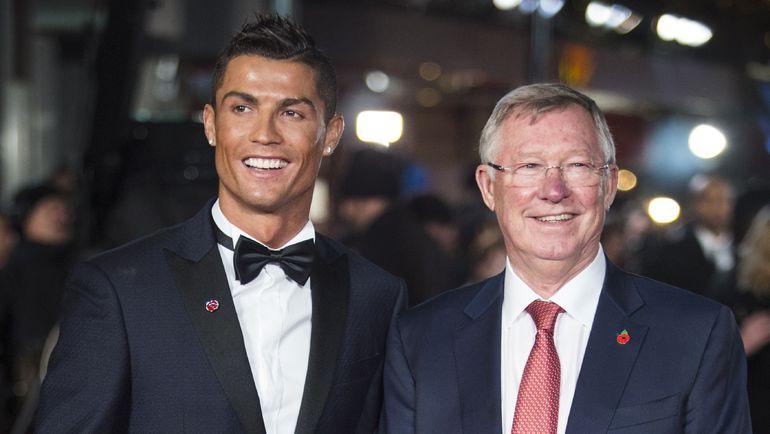 Криштиану РОНАЛДУ (слева) и Алекс ФЕРГЮСОН на премьере фильма Ronaldo. Фото AFP
