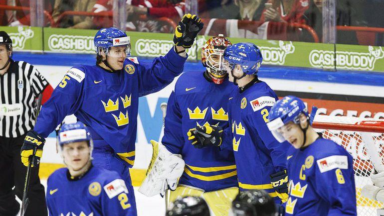 Четверг. Хельсинки. Канада - Швеция - 2:5. Сборная Швеции празднует победу над канадцами. Фото AFP