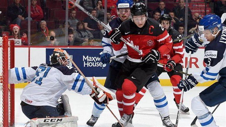 Финляндия - Канада: дальше пойдет только один. Фото IIHF