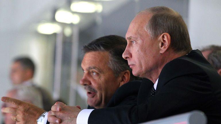 Рене ФАЗЕЛЬ и Владимир ПУТИН. Фото REUTERS