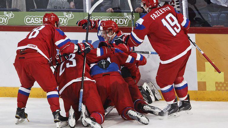 Вторник. Хельсинки. Россия - Финляндия - 3:4 ОТ. Только что Андрей СВЕТЛАКОВ провел гол за шесть секунд до финальной сирены. Но этого было мало. Фото REUTERS