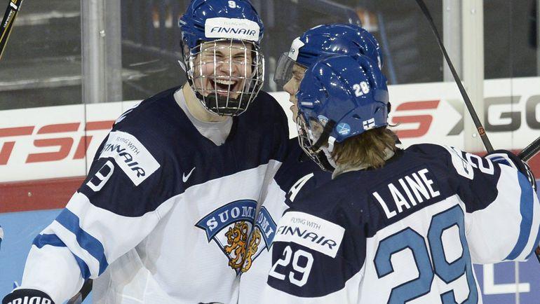 Йессе ПУЛЮЯРВИ и Патрик ЛАЙНЕ. Фото Reuters