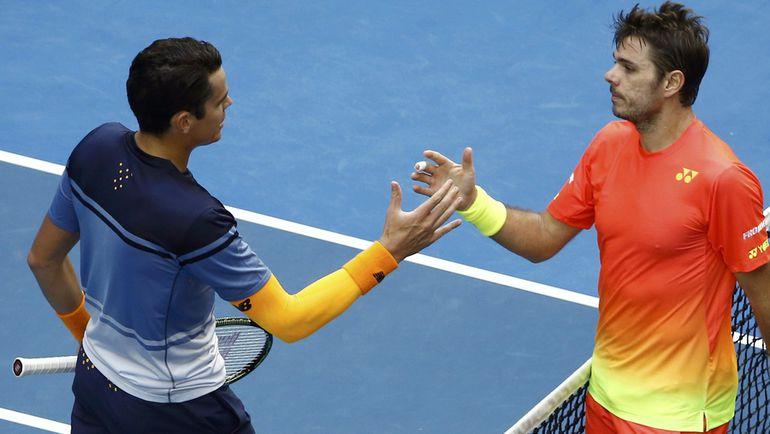 Понедельник. Мельбурн. Милош РАОНИЧ (слева) и Стэн ВАВРИНКА благодарят друг друга за игру. Фото AFP
