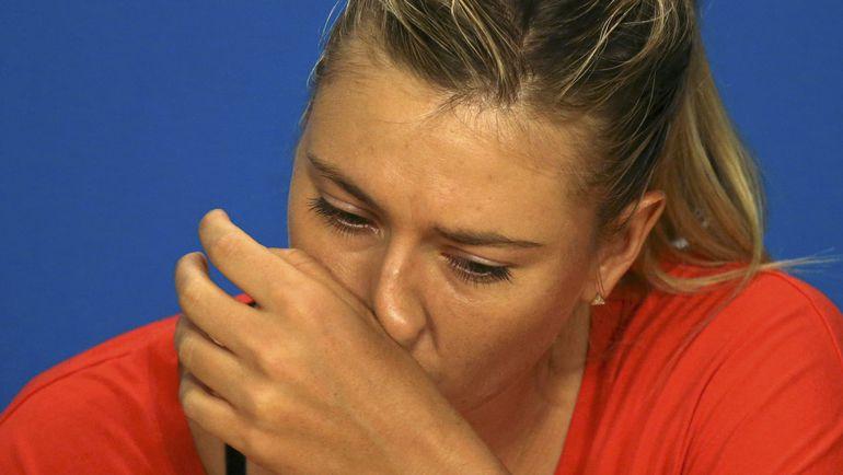 Мария ШАРАПОВА проиграла в четвертьфинале Australian Open Серене Уильямс. Фото AFP