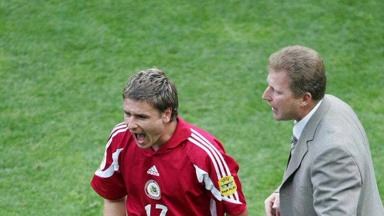 Марьян ПАХАРЬ и Александр СТАРКОВ в сборной Латвии. Фото REUTERS