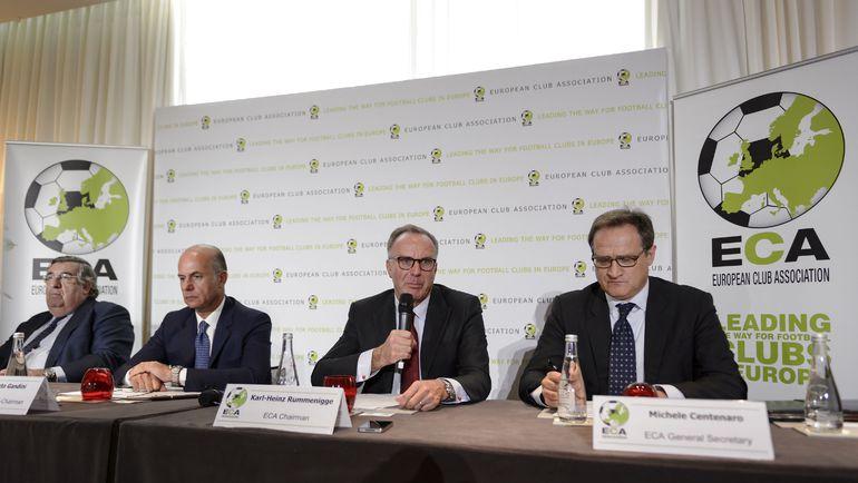 Умберто ГАНДИНИ (второй слева) и президент ECA Карл-Хайнц РУММЕНИГГЕ (второй справа). Фото AFP