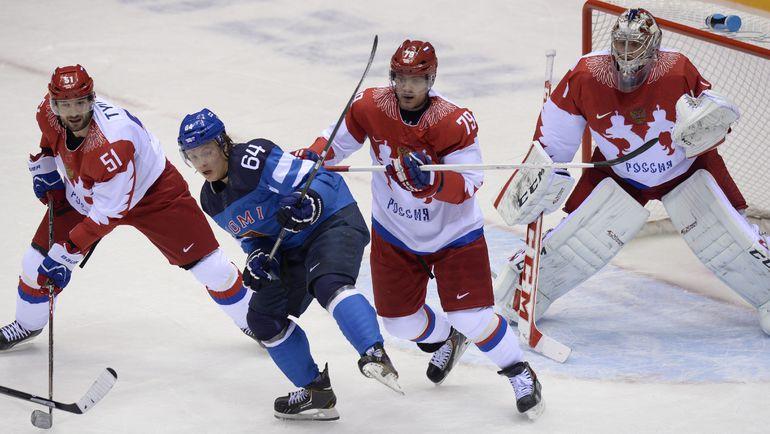 Игроки олимпийской сборной России Федор ТЮТИН, Андрей МАРКОВ и Семен ВАРЛАМОВ. Фото AFP