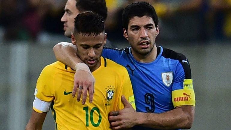 Пятница. Ресифи. Бразилия – Уругвай – 2:2. НЕЙМАР и Луис СУАРЕС покидают поле. Фото Reuters