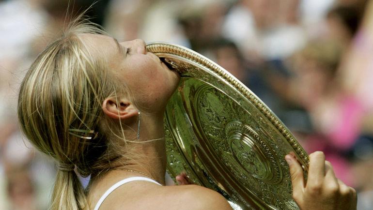 3 июля 2004 года. Лондон. Мария ШАРАПОВА - чемпионка Уимблдона после финала с Сереной Уильямс. Фото Reuters
