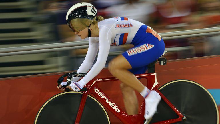 Евгения РОМАНЮТА на олимпийском треке в Лондоне. Фото AFP