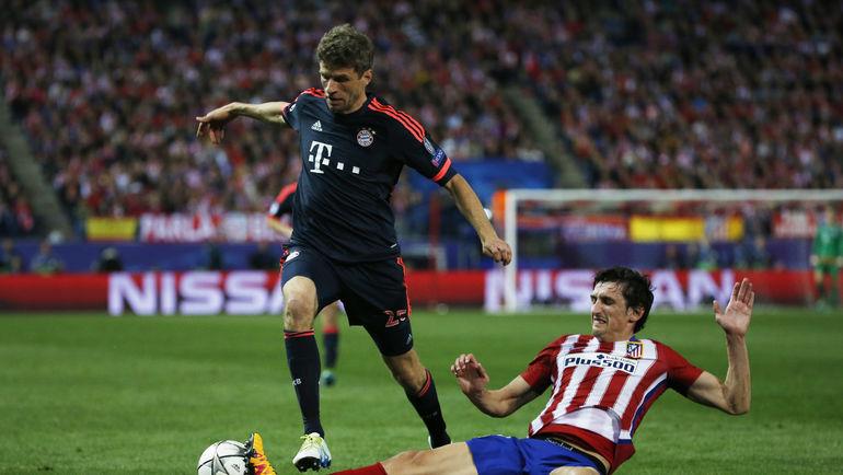 """В первом матче с """"Атлетико"""" Томас МЮЛЛЕР (слева) вышел лишь на замену. Фото Reuters"""