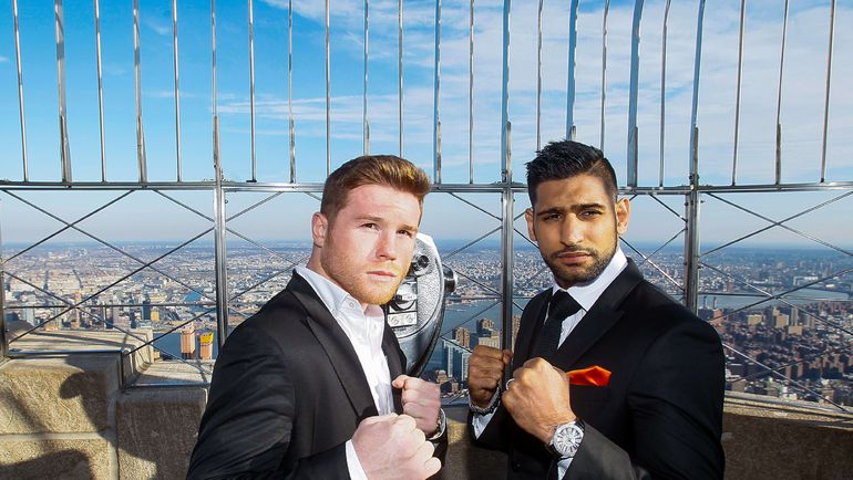 Саул АЛЬВАРЕС (слева) и Амир ХАН. Фото AFP