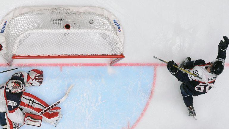 Сегодня. Санкт-Петербург. США - Словакия - 2:3 ОТ. Марко ДАНЕ забивает гол в овертайме. Фото AFP
