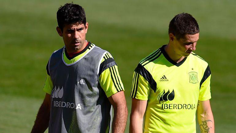 Форварды ДИЕГУ КОСТА и Фернандо ТОРРЕС (справа), забившие в этом сезоне за свои клубы 16 и 12 мячей  соответственно, стали не нужны главному тренеру сборной Испании Висенте дель Боске. Фото AFP