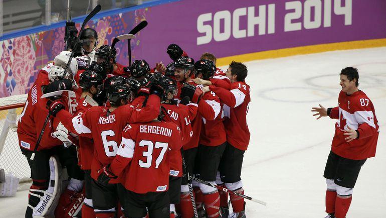 Канадцы празднуют олимпийское золото Сочи-2014. Фото Reuters