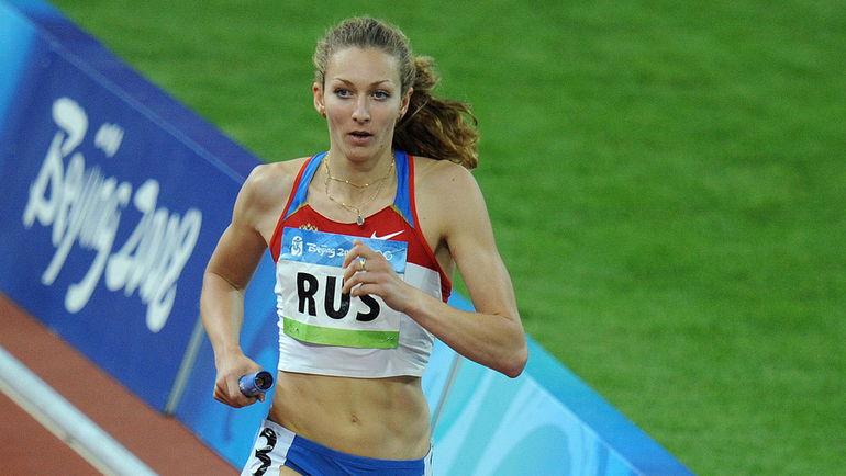 Татьяна ФИРОВА в олимпийском Пекине-2008. Фото AFP