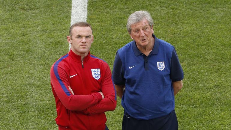 Капитан сборной Англии Уэйн РУНИ (слева) и главный тренер Рой ХОДЖСОН. Фото Reuters