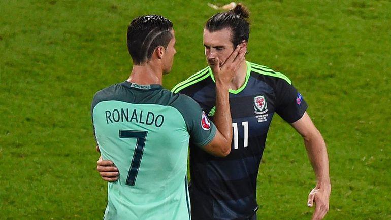 Среда. Лион. Португалия - Уэльс - 2:0. Криштиану РОНАЛДУ (слева) и Гарет БЭЙЛ. Фото Reuters
