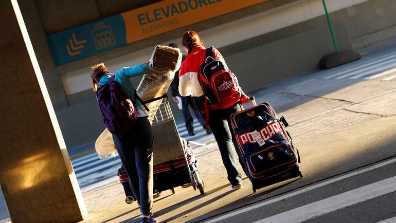 Воскресенье. Рио-де-Жанейро. Первые представители сборной России прибывают в столицу XXXI Олимпийских игр. Фото Reuters