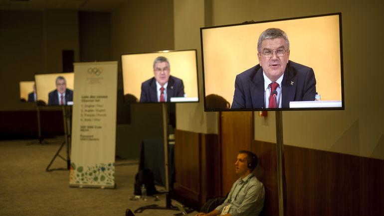 Вскоре глава МОК Томас Бах и его коллеги должны уступить место на экранах участникам Игр. Фото AFP