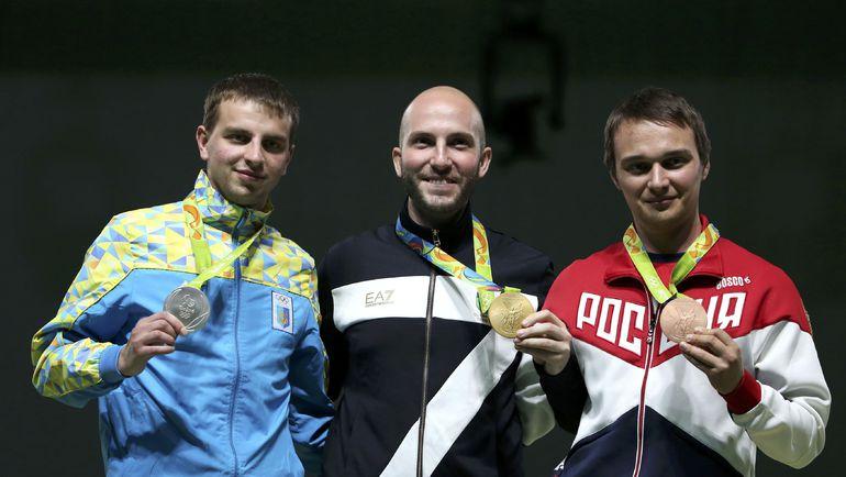 Владимир МАСЛЕННИКОВ (справа), Никколо КАМПРИАНИ (в центре) и Сергей КУЛИШ. Фото REUTERS