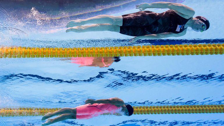 Сегодня. Рио-де-Жанейро. Женщины. 100 м брасс. Финал. Юлия ЕФИМОВА(внизу). Фото AFP