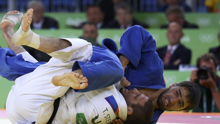 Хасан ХАЛМУРЗАЕВ побеждает в финале Тревиса СТИВЕНСА. Фото REUTERS