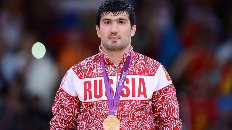 Тагир ХАЙБУЛАЕВ с золотой медалью Лондона-2012. Фото AFP