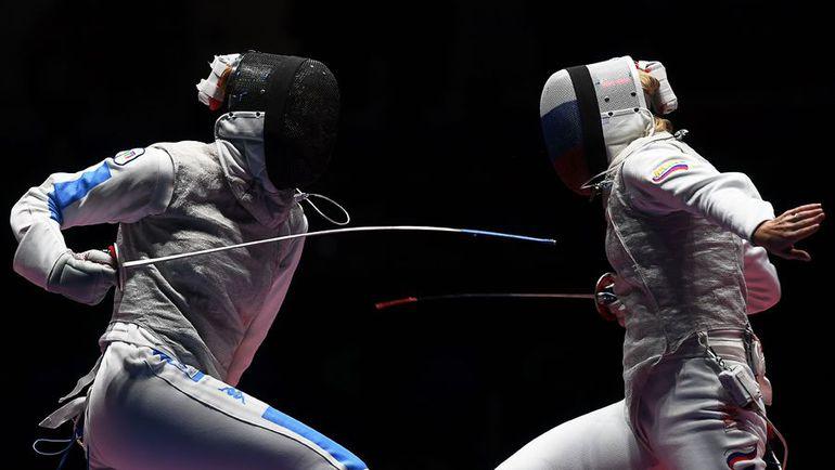 Инна ДЕРИГЛАЗОВА (справа) и Элиза ДИ ФРАНЧИСКА. Фото AFP