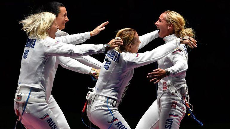 Четверг. Рио-де-Жанейро. Сборная России празднует победу в поединке за третье место. Фото AFP
