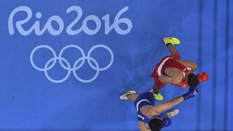 Бой Евгения ТИЩЕНКО против Рустама ТУЛАГАНОВА. Фото REUTERS
