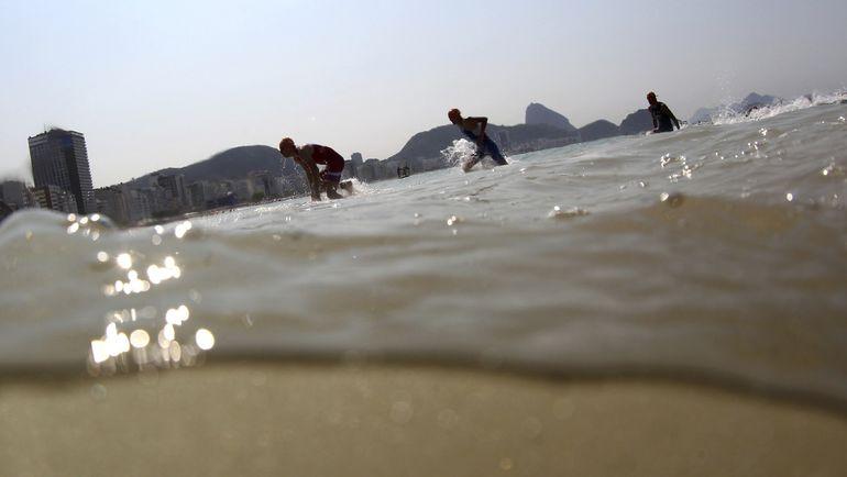 Выход спортсменов из воды. Фото REUTERS