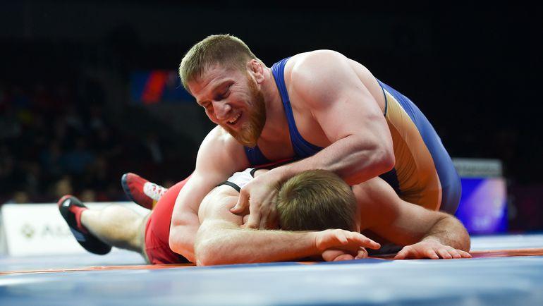 Анзор БОЛТУКАЕВ (в синем). Фото AFP