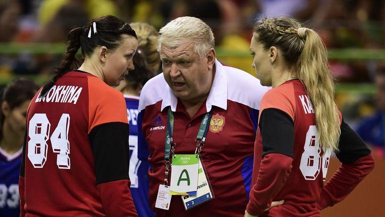 Евгений ТРЕФИЛОВ (в центре). Фото AFP