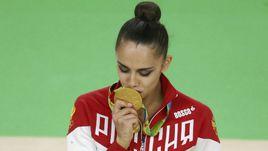 Маргарита МАМУН с золотой медалью Рио.