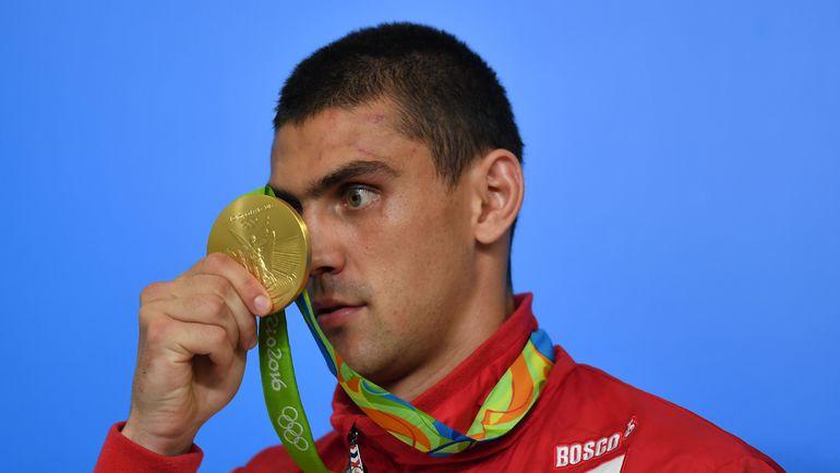 Евгений ТИЩЕНКО с золотой медалью. Фото AFP