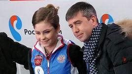 Юлия ЛИПНИЦКАЯ с тренером Алексеем УРМАНОВЫМ (справа).