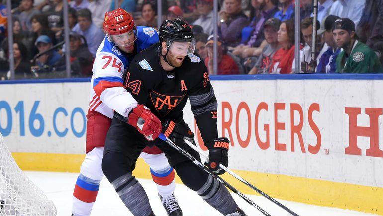 Никита ЗАЙЦЕВ и Шон КУТЮРЬЕ. Фото AFP