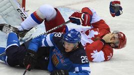 Алексей ЕМЕЛИН (№74) в матче с Финляндией в четвертьфинале Олимпиады в Сочи. Россияне тогда уступили 1:3.