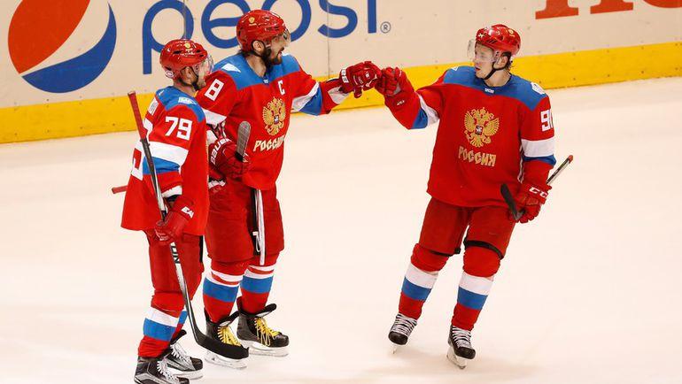 Андрей МАРКОВ, Александр ОВЕЧКИН и Владимир ТАРАСЕНКО. Фото AFP