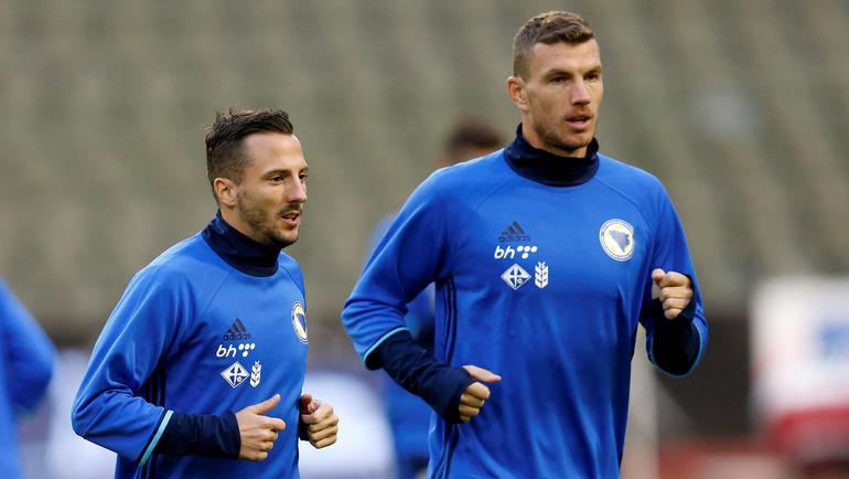 Даниэль МИЛИЧЕВИЧ (слева) и Эдин ДЖЕКО на тренировке сборной Боснии и Герцеговины. Фото REUTERS