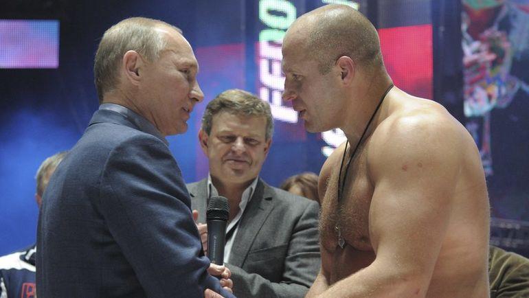 Федор ЕМЕЛЬЯНЕНКО и Владимир ПУТИН. Фото Reuters