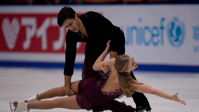 Кейтлин УИВЕР и Эндрю ПОЖЕ. Фото AFP