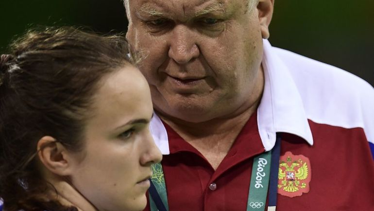 Анна ВЯХИРЕВА и Евгений ТРЕФИЛОВ. Фото AFP