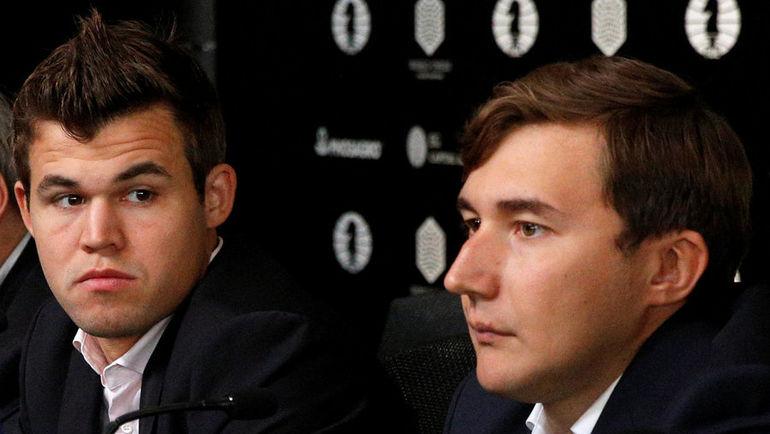 Магнус КАРЛСЕН (слева) и Сергей КАРЯКИН. Фото Reuters
