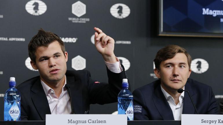Магнус КАРЛСЕН (слева) и Сергей КАРЯКИН. Фото AFP
