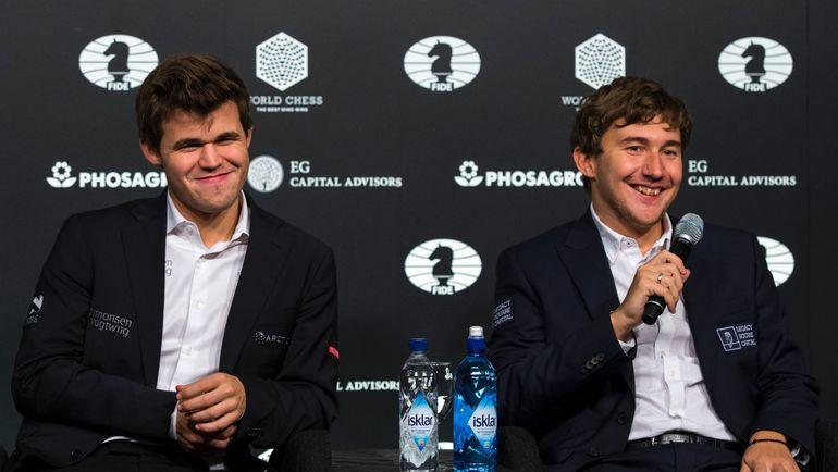 Магнус КАРЛСЕН (слева) и Сергей КАРЯКИН на заключительной пресс-конференции. Фото AFP