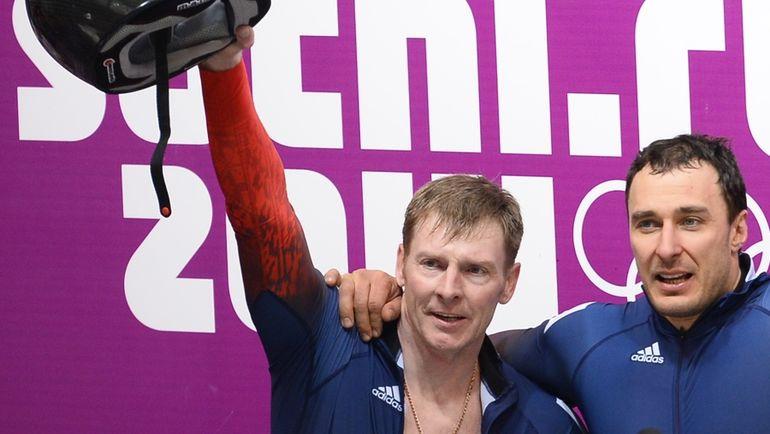 Двукратные олимпийские чемпионы Сочи Александр ЗУБКОВ и Алексей ВОЕВОДА. Фото AFP