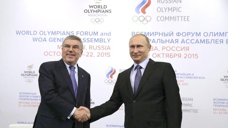 Томас БАХ (слева) и Президент России Владимир ПУТИН. Фото Reuters