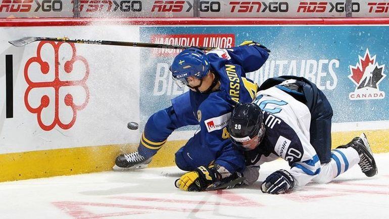 Действующие победители МЧМ финны выбыли из борьбы уже после группового турнира. Фото IIHF